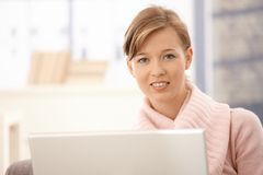 Attractive woman using laptop at home Stock Images
