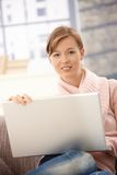 Attractive woman using laptop at home Royalty Free Stock Photo