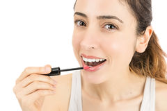 Attractive woman using lip stick Stock Photo