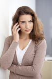 Attractive woman using mobile at home Royalty Free Stock Images