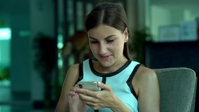 Attractive woman using a mobile phone to chat, chat, read and laugh. Close-up. 4k. Attractive woman using a mobile phone to chat, chat, read and laugh. Close-up stock video footage