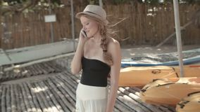 Attractive woman using phone in tropical resort. stock footage