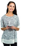 Attractive woman using smartphone and smiling at camera. Standing on white screen stock image