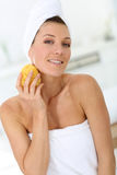 Attractive woman using sponge Stock Photography