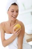 Attractive woman using sponge Stock Image