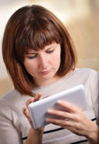 Attractive woman using a tablet-pc Stock Photo