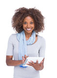Attractive woman using tablet pc Royalty Free Stock Photography
