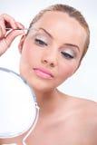 Attractive woman using tweezers Stock Images