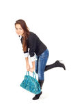Attractive woman with a very heavy bag Stock Photos