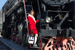 Attractive woman and vintage train Royalty Free Stock Images