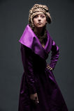 Attractive woman in violet dress Royalty Free Stock Image