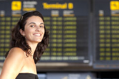 Attractive woman waiting at the airport Royalty Free Stock Photos