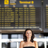 Attractive woman waiting at the airport Royalty Free Stock Photo
