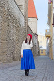 Attractive woman walking in ancient town Royalty Free Stock Photography