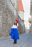 Attractive woman walking in ancient town of Tallinn, Estonia Stock Photos