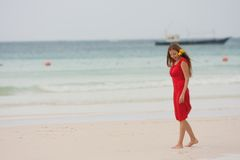 Attractive woman walking on beach Royalty Free Stock Photo