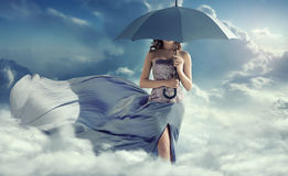 Attractive woman walking on the clouds Royalty Free Stock Images