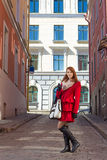 Attractive woman walking in old town of Tallinn. Estonia Stock Photography