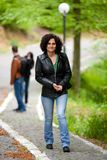 Attractive woman walking outdoors Royalty Free Stock Image