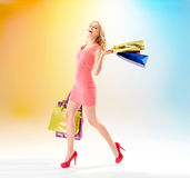 Attractive woman walking with shopping bags Stock Photography