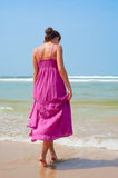 Attractive woman walking in to the ocean Royalty Free Stock Image
