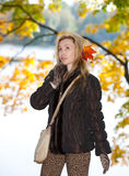 Attractive woman walks in autumn park Royalty Free Stock Image