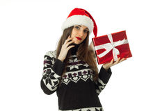 Attractive woman in warm sweater and santa hat Stock Photography