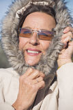 Attractive Woman warm winter jacket Stock Photo