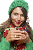 Attractive woman warming up with a cup of hot tea Royalty Free Stock Image