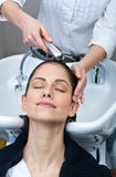 Attractive woman washing her hair Stock Photography