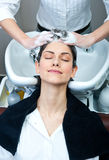 Attractive woman washing her hair Royalty Free Stock Image