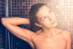 Attractive woman washing her hair in the shower Royalty Free Stock Photos