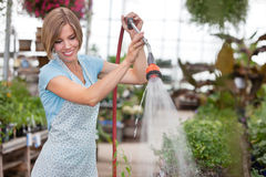 Attractive woman watering the plants Stock Photo