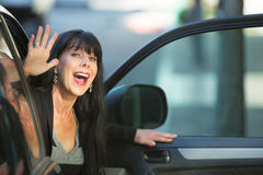Attractive Woman Waving From Car Stock Photography
