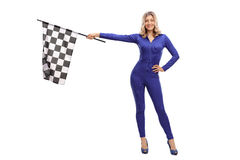 Attractive woman waving a race flag Stock Images