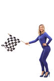 Attractive woman waving a race flag Stock Image