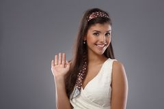 Attractive woman waving, smiling Royalty Free Stock Photo