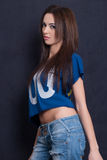 Attractive woman wear blue crop top and ripped blue jean pants Royalty Free Stock Photography