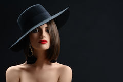 Attractive Woman Wearing A Hat Posing On Black Background Stock Images