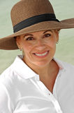 Attractive Woman Wearing a Brown Summer Hat Royalty Free Stock Image