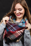 Attractive woman wearing checkered scarf. Royalty Free Stock Photo