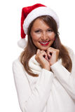 Attractive woman wearing a festive red Santa hat Royalty Free Stock Image