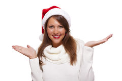 Attractive woman wearing a festive red Santa hat Stock Photography