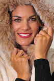 Attractive woman wearing fur coat stock photography