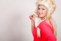Attractive woman wearing furry winter hat Royalty Free Stock Image