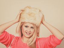Attractive woman wearing furry winter hat Royalty Free Stock Photo