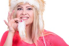 Attractive woman wearing furry winter hat Royalty Free Stock Images