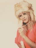 Attractive woman wearing furry winter hat Stock Photo