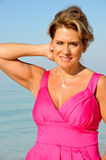 Attractive Woman Wearing A Pink Dress Royalty Free Stock Photography