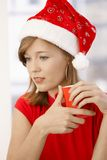 Attractive woman wearing Santa Claus hat Stock Image